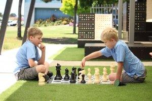 2 boys playing chess
