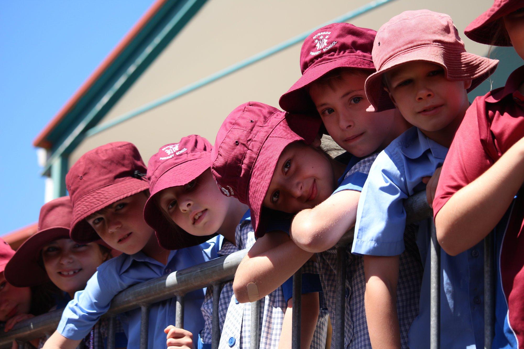 Children leaning over rail